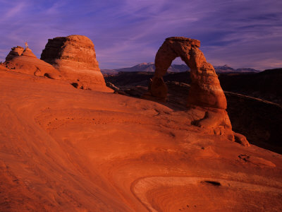 Hikers View Delicate Arch at Sunset, Utah, USA